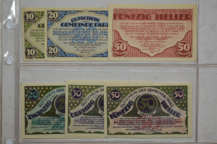 Austrian Notgeld housed in a three-ring looseleaf binder.