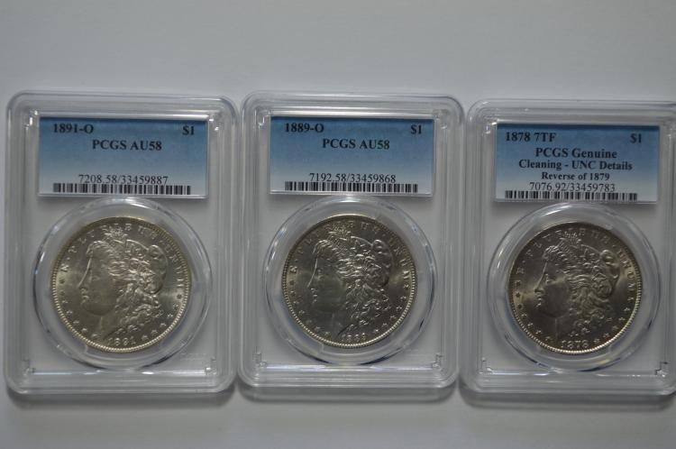 A premium quality uncommon date certified Morgan Dollar trio