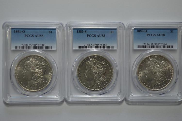 A high circulated grade PCGS certified Morgan Dollar threesome