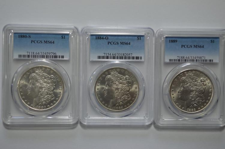 A handsome certified Very Choice Morgan Dollar trio