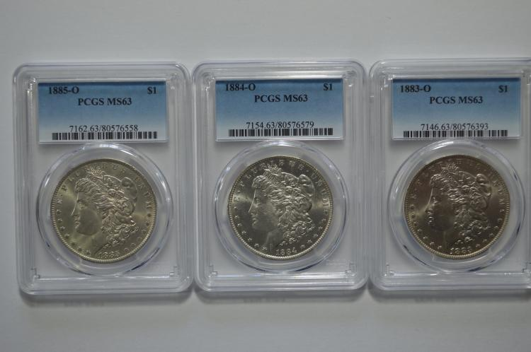 A trio of premium quality PCGS certified New Orleans Mint Silver Dollars