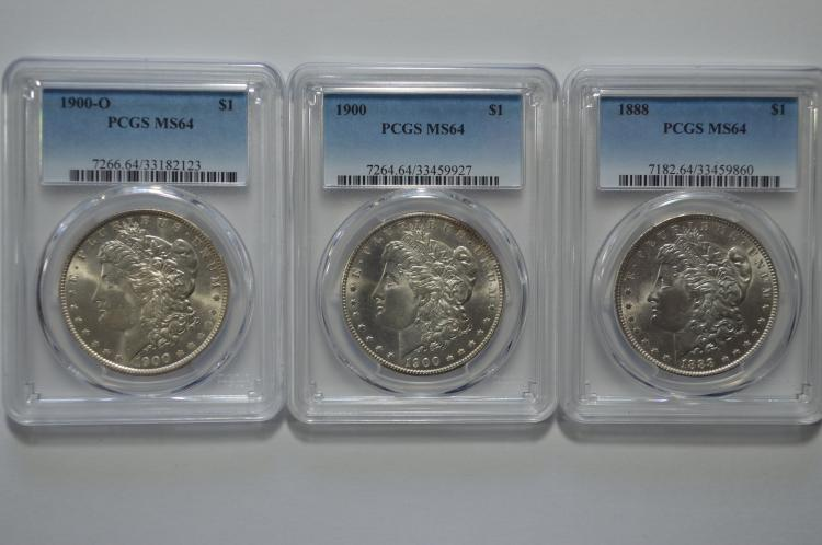 A trio of certified Very Choice Morgan Dollars