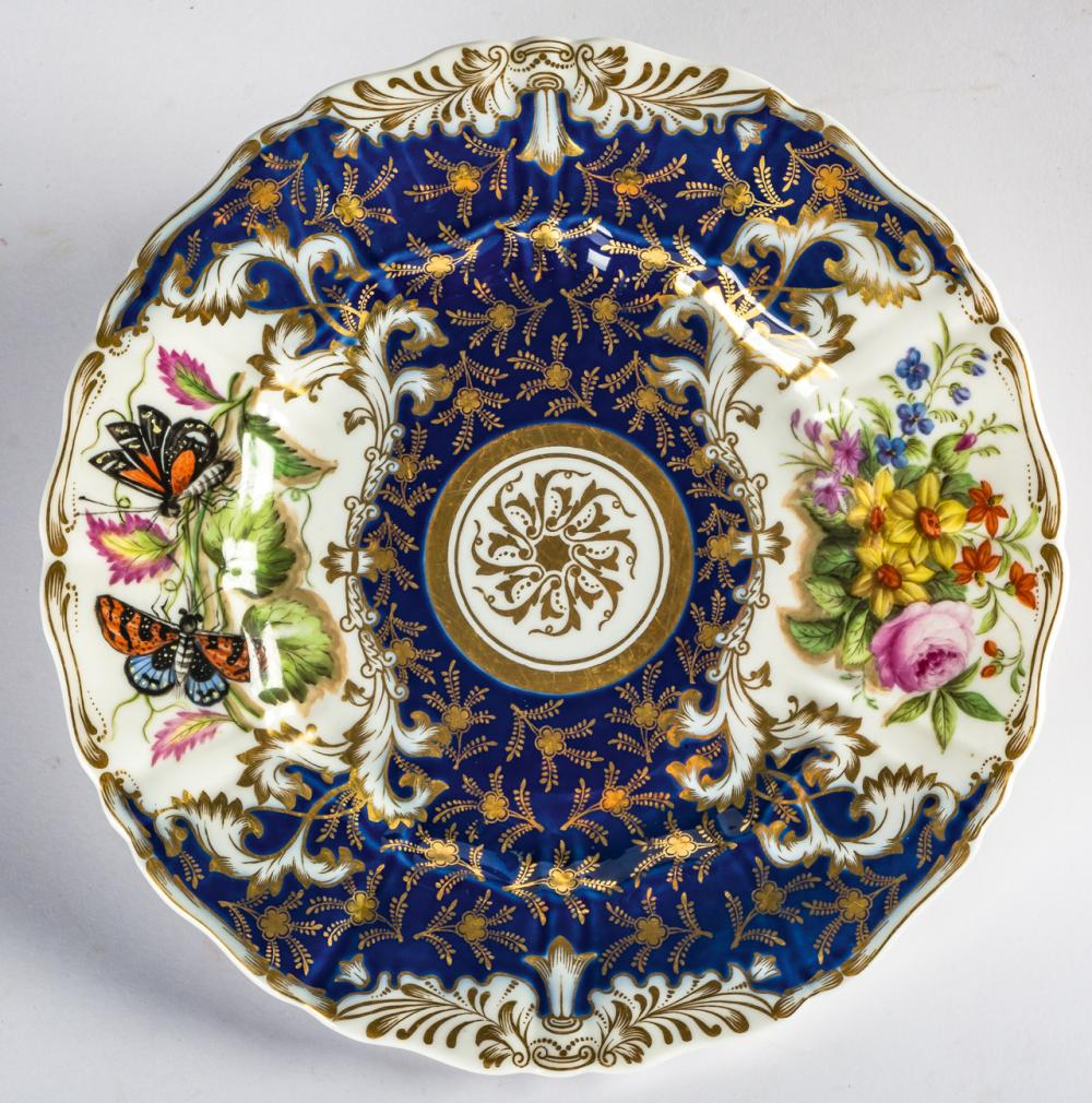 A RUSSIAN PORCELAIN PLATE WITH FLOWERS AND BUTTERFLIES