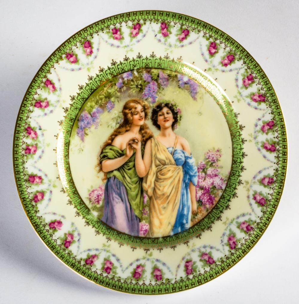 A PORCELAIN PLATE WITH ROMANTIC SCENE