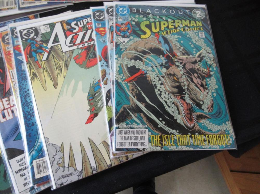 Lot 128: 21 Superman In Action Between 658-819