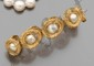 Bracelet en boucles d'or jaune satiné,