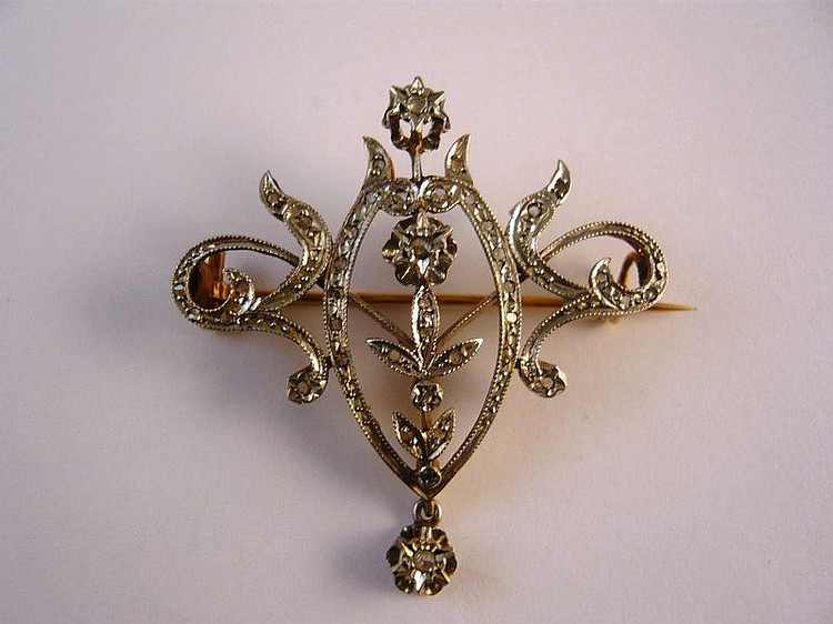 Broche en or jaune et or gris