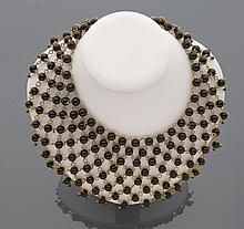 CELINE Lot de deux colliers draperie en résille de métal doré agrémentés l'un de perles d'imitation blanches et l'autre de perles de verre noir.    Non signés