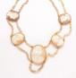 Collier deux rangs de perles baroques centré de camées figurant des personnages antiques de profil.       Longueur : 37 cm environ.      Poids : 48,29 g. (accident au fermoir).   A pearl and camee necklace.
