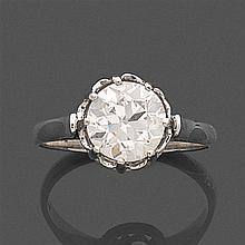 BAGUE en or gris et platine, ornée d'un diamant