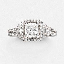 ELEGANTE BAGUE en or gris, sertie d'un diamant