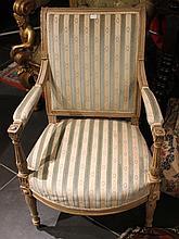 Paire de fauteuils en bois laqué crème  Style Empire  Dossier à léger enroulement, support d'accotoire en balustre cannelé  Garniture postérieure rayée blanche et bleu ciel.