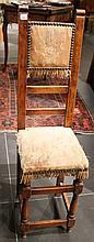 Petite chaise en bois naturel, assise et dossier tendus de tapisserie très usée.