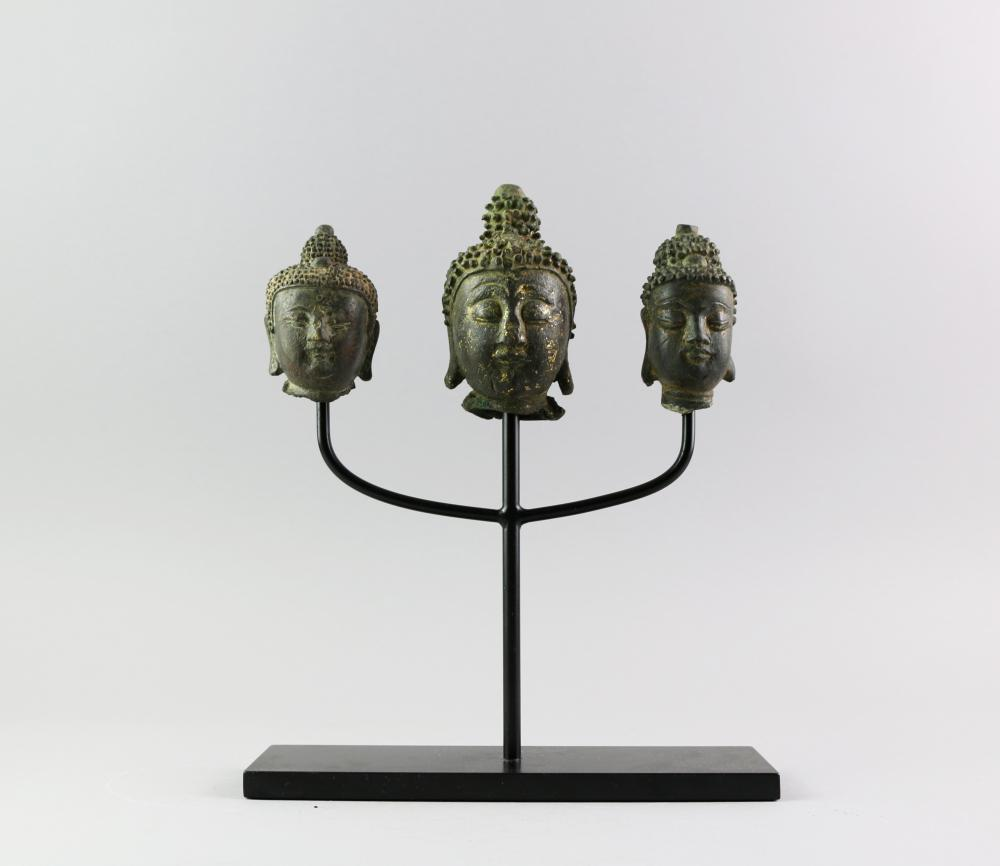 3 Buddha head sculputres on one stand