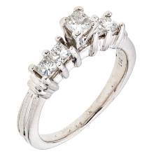 A platinum ring with 5 princess cut diamonds ~0.94 carats.