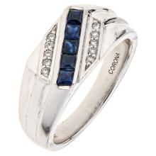 A platinum ring with 5 square cut sapphires ~0.60 carats and 10 brilliant cut diamonds.