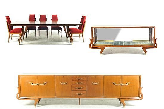 Comedor. Elaborado en madera. Consta de: a) Trinchador. b) Buffet. c) Mesa. d) 8 Sillas. Piezas: 11