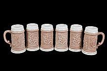 Juego de tarros cerveceros. Origen alemán. Elaborados en cerámica. Decorados con escenas costumbristas. Piezas: 6