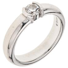 TIFFANY & CO. platinum solitaire ring with 1 brilliant cut diamond ~0.34 carats.