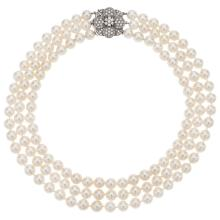 A three strands necklace with cultured pearls and 14K white gold clasp with 91 brilliant cut diamonds.