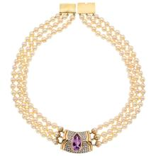 An 18K and 14K yellow gold necklace with 153 cultured pearls, 1 pear shaped amethyst and 79 single cut diamonds.