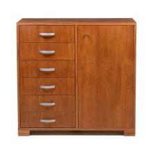 Cómoda. Siglo XX. Fabricada por López Morton. Color marrón. Elaborada en madera aglomerada y enchapada de tzalam.