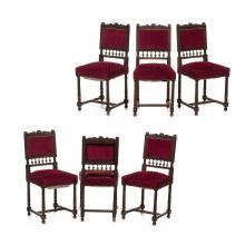 Juego de sillas. Francia. S. XX. Estilo Enrique II. Elaboradas en madera tallada de nogal. Tapicería terciopelada color vino. Piezas: 6