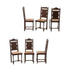 Juego de sillas. Francia. Siglo XX. Estilo Bretón. Elaboradas en madera tallada de roble. Con respaldos labrados. Piezas: 6