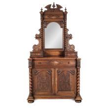 Tocador con espejo. Francia. Siglo XX. Elaborado en madera tallada de nogal. A 2 cuerpos.