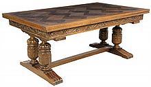 A FRENCH RENAISSANCE STYLE OAK TRESTLE TABLE