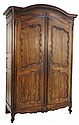 AN ANTIQUE LOUIS XV STYLE WALNUT FINISH ARMOIRE