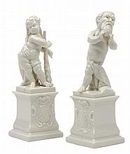A PAIR OF NYMPHENBURG BLANC DE CHINE PUTTO FIGURES