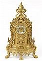 A ROCOCO LOUIS XV STYLE BRASS FINISH MANTLE CLOCK