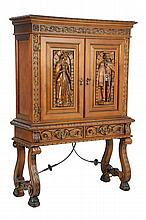 A SPANISH STYLE CARVED CABINET ON STAND