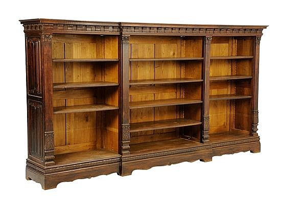 A GOTHIC REVIVAL CARVED WALNUT BOOKCASE