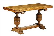 A SPANISH STYLE OAK FLIP-TOP DINING TABLE