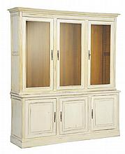 AN ITALIAN STYLE PAINTED BREAKFRONT CABINET
