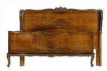 A VENETIAN STYLE WALNUT BED
