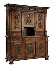 A RENAISSANCE REVIVAL CARVED WALNUT CABINET ARMOIRE