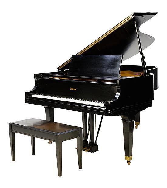 A BALDWIN EBONIZED GRAND PIANO