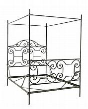 A WROUGHT IRON FOUR-POST BED