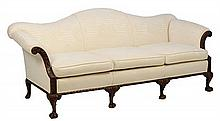 A CHIPPENDALE STYLE CAMELBACK SOFA