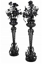 A PAIR OF LOUIS XV STYLE EBONIZED METAL STANDING URNS