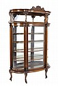 A LOUIS XV STYLE CURVED VITRINE CABINET WITH GARGOYLES