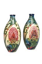 Moorcroft, a pair of 'Firewheel Banksia' vases, 2006
