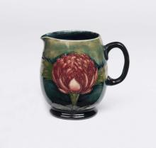 William Moorcroft, a small green gound Waratah jug, circa 1930