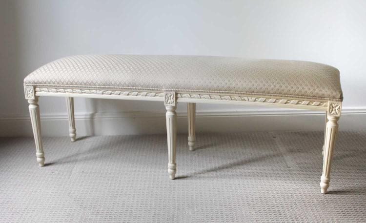 A white panted and upholstered bench seat White upholstered bench