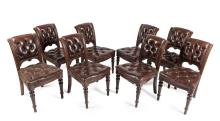 An Edwardian cedar extension dining table together with eight leather upholstered chesterfield dining chairs