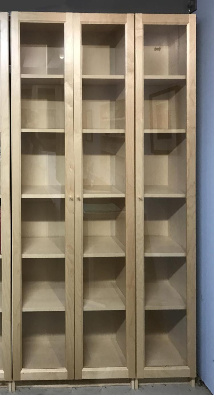 eight double and two single glass fronted ikea bookcases