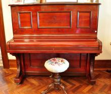 A Steinway & Sons mahogany cased upright piano, late19th/20th century â??